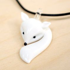 I have an identical one in blue, but I'm loving the white fox too!