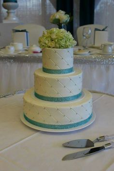 3-tier wedding cake with our quilted pattern and blue bling. www.mitchels.ca #wedding #weddingcakes #3tier #flowers