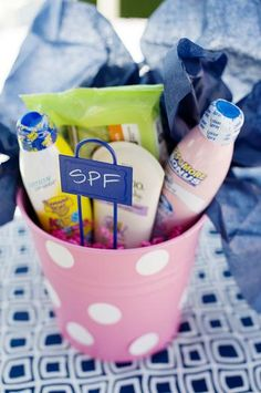 SPF Bucket for a pool party.  Such a cute idea~!