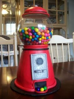 Gumball Machine This is my first attempt at a gumball machine. It is iced in buttercream with fondant details. I used ideas from several...