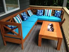 DIY outdoor sectional X design wood with coffee table ice tray built in so cool!  plans by http://ANA-WHITE.com