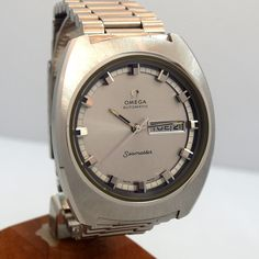 1970 Vintage Omega Day - Date Automatic Seamaster Ref. 166.111 Stainless Steel watch with Original Silver Dial with Applied Steel Thick Beveled Rectangle Markers with Original Omega Stainless Steel Br