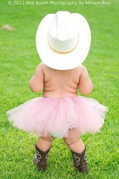 Baby cowboy in a tutu and cowboy hat and boots ! :)