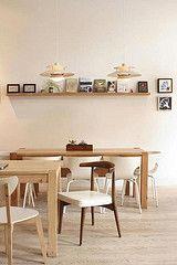 blonde wood, white interiors white chairs, mixed woods