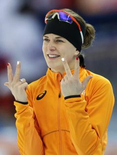 Ireen Wust becomes first openly gay athlete to medal in Sochi  Ireen Wust of the Netherlands flashes three fingers in each hand, indicating her third olympic gold medal, after winning gold in the women's 3,000-meter speedskating race at the Adler Arena Skating Center during the 2014 Winter Olympics, Sunday, Feb. 9, 2014, in Sochi, Russia.
