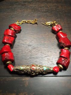 Chunky deep red coral necklace with a large brass Nepal bead pendant. Made by Jayanthi Kanderi for Mahasara. Coral Jewelry, Beaded Jewelry, Beaded Necklace, Necklaces, Bracelets, Tribal Necklace, Tribal Jewelry, Bohemian Jewelry, Turquoise