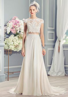French lace appliques adorn the bodice of this crop-top, two-piece wedding dress. The keyhole back finishes off this boho-chic dress.