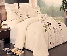 Modern Ivory Purple Floral Embroidered 100 percent Egyptian 5 piece Duvet Comforter Cover and Shams Set with Decorative Pillows.  The bedding set features green and purple  embroidered flowers for a modern look.