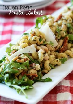 Italian Pesto Pasta Salad - Parmesan, sun-dried tomatos, pesto and arugula. So fabulous!