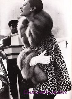 If you're going to do some holiday shopping today, you might as well go in style. Here, a double-breasted leopard jacket trimmed with red fox fur by Traina-Norell, 1954. Of course, it is no longer legal to buy or sell furs from endangered species whether vintage or not, and we are not advocating such. But, there are wonderful quality faux furs available today and we hope you'll use this photo as inspiration to look your best today and every day.