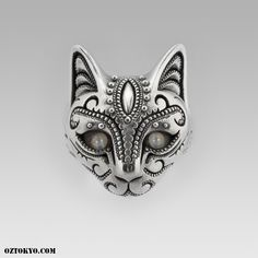"Mesmerizing and magical piece of wearable art. La` Moo is a flawless and extremely luxurious ring featured here with natural ""Cats Eye"" eyes.  Standard setting design and level of craftsmanship to complete this unique piece of jewelry.  100% handmade from sterling silver and available in a wide range of sizes. #cat #catring #ozabstract"