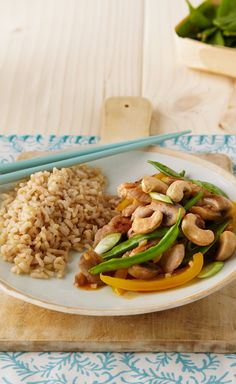 Pork, Snow Pea & Mushroom Stir-Fry — Savory pork simmered in a tangy Asian sauce with snow peas and cashews create a better-for-you stir-fry. No need to order out tonight!