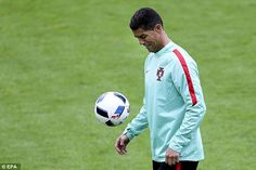 Ronaldo practises his close control as he gears up for his side's crucial Group F clash with leaders Hungary