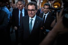 President of Catalonia Artur Mas leaves the Catalan Parliament after the approval of the Law allowing Catalonia's Government to call on a self-determination referendum from Spain on September 19, 2014 in Barcelona, Catalonia. The Catalonian Parliament votes today to approve the law allowing to call on a self-determination referendum.