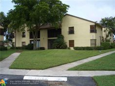 Coconut Creek FL Condo 1st floor screened porch lake view