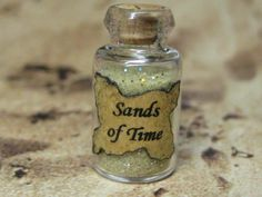 dollhouse miniature potion bottle sands of time for sorcerer, witch, wizard, or fairy. $3.99, via Etsy.