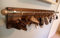 Hanging shoes with a curtain rod. | 33 Ingenious Ways To Store Your Shoes