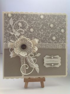 "su mocha morning designer series papers,crumb cake card stock and the lovely ""mixed bunch"" stamp set and complimentary punch.a touch of su victoria lace ribbon a few pearls ,not to mention a gorgeous su antique brad for my flower centre"