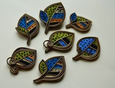 Wool felt and zipper leaf brooches, woolly fabulous, via Flickr.