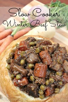 Beef stew in a bread bowl is even better when it is made in a slow cooker. This crock pot beef stew recipe will save you time and warm you up on cold winter nights! #CampbellsSauces #ad