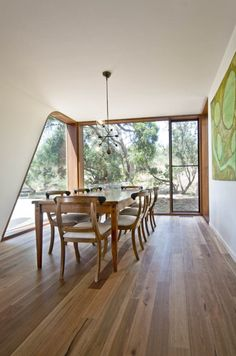 Dining room within the garden at Bluff House Barwon Heads by Auhaus Architecture