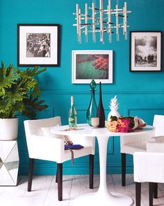 Turquoise walls with white furniture. This is too modern for you, but how clean and refreshing is this palette. Please consider going all white on your living room furniture with pops of pattern and color on pillows and throws......
