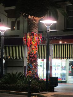yarnbombing for Jumpers & Jazz in July, 2016 - one of the 'tree jumpers' installed in the main street in Warwick, Qld, Australia - the jumper for this tree was a collaborative project by freeform crocheters from all around the world, coordinated by Prudence Mapstone www.knotjustknitting