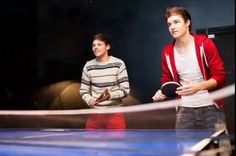 Louis and Liam playing ping-pong.