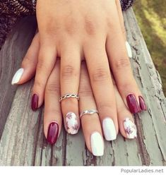 Burgundy and white gal nails with nice rings