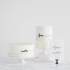 black and white cake and wedding invitation