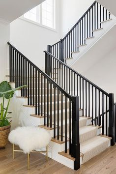 Light gray herringbone pattern staircase runner covers a light oak staircase wit… Light gray herringbone pattern staircase runner covers a light oak staircase with black wooden spindles surrounding white walls and chic accents. Black Stair Railing, Black Staircase, Staircase Runner, House Staircase, Stair Railing Design, Staircase Remodel, Staircase Makeover, Staircase Railings, Stair Decor