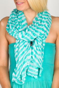 Cute scarf but I wouldn't put it with blue, kind of clashes..