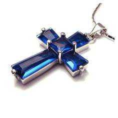 'BLUE SAPPHIRE CROSS 18K WHITE GP PENDANT' is going up for auction at 12pm Wed, Aug 1 with a starting bid of $10.