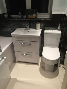 Becky from High Wycombe uses a monochrome style with sleek bathroom furniture to create a great contempory design. Bathroom Design Software, Bathroom Design Layout, Bathroom Tile Designs, Bathroom Design Small, Bathroom Colors, Modern Small Bathrooms, Grey Bathrooms, Modern Bathroom, Natural Bathroom