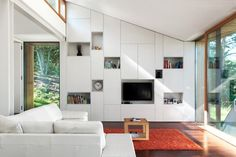 House MJ by Kombinat, wall storage and peaked roof