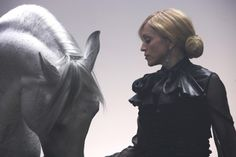 Madonna in an intimate picture with one of her horses for a magazine shoot