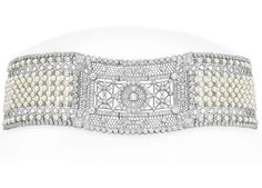 A BELLE EPOQUE PEARL AND DIAMOND CHOKER NECKLACE, BY BLACK STARR & FROST  Of foliate design, centering upon a pierced collet-set diamond lacework plaque, to the seed pearl latticework choker, decorated with old European-cut foliate trim, mounted in platinum, circa 1905, 13¼ ins.  Signed B. S. & F. for Black, Starr & Frost