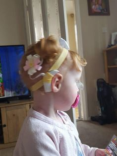 Check out this item in my Etsy shop https://www.etsy.com/uk/listing/614299513/cochlear-implant-hearing-aid-headband