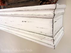 DIY mantle shelf- I think I want ours to be wide enough for frames and also to use some prettier trim than this, but it's the idea.