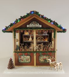 This photo is of Cynthia Howe Miniatures   online class project, a 1/12 scale Christmas Market Stall.