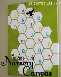 Love this honeycomb nursery wall canvas from Positively Splendid!