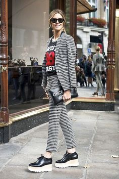 Photo via: The Fashion Spot This street style star shows us her quirky take on the pant suit and we are completely on board! Admiring the unique way she effortlessly styles her bold grid print suit wi