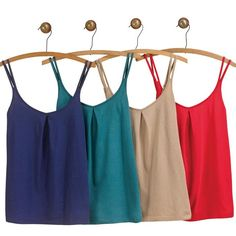 Four differently colored camis (navy, teal, beige and red) in one pack. Each features a soft, rounded v   neck  Imported