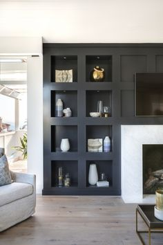 modern built ins around modern fireplace, dark gray builts in in modern meets traditional living room decor, neutral modern living room design, Jet Black Built-in Bookcase Jet Black Built-in Bookcase Bookcase Cabinetry Paint Grade with square detail Living Room Decor Traditional, Living Room Modern, Living Room Designs, Modern Traditional Decor, Living Rooms, Small Living, Built In Wall Shelves, Built In Bookcase, Black Bookcase