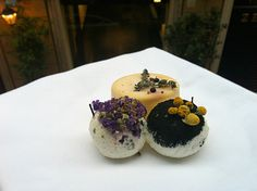 Fresh goats cheeses adorned with black ash, dried wildflowers, camomile buds and mountain herbs