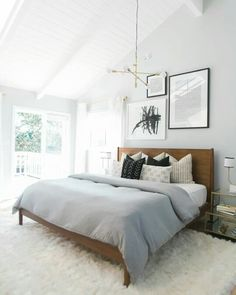 Simple bedroom. I like the color of the wall.