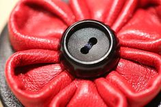 Handmade leather Kanzashi flower brooch with vintage button by MooshiMode