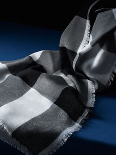 Add a complimentary monogram to your light-weight Burberry cashmere scarf, available in a choice of prints and block colours.