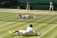 Grigor Dimitrov and Novak Djokovic both fall to the ground on Centre Court - Scott Heavey/AELTC