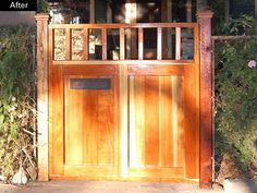 Wood gate entrance to bungalow house early 20th century bungalow inspiration. Also functions as a mailbox!